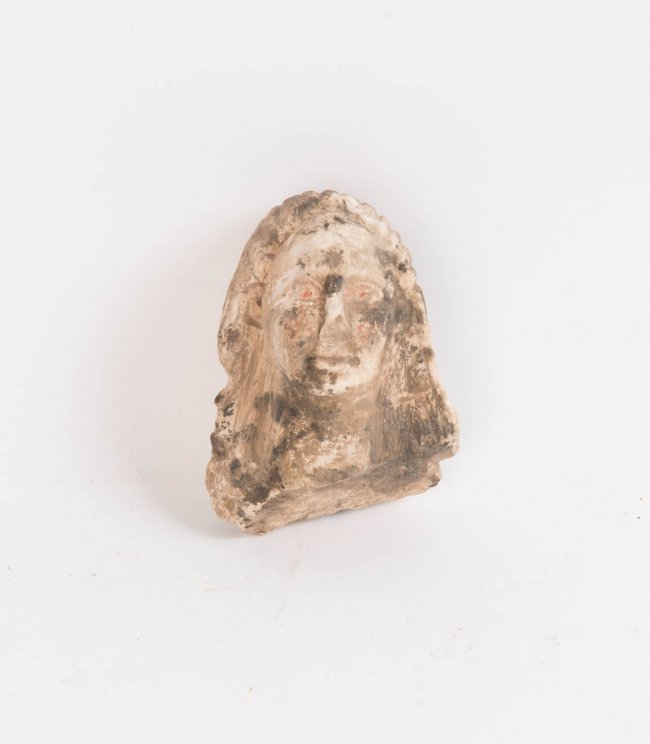 A small carved stone head fragment probably italian lot