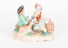 A German Dresden Porcelain Group Of A Girl And Boy With