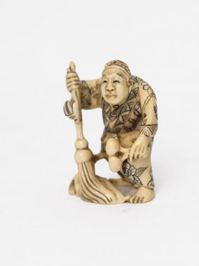 A Japanese Ivory Netsuke Of A Man With A Mop, 19th/20th
