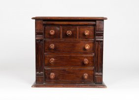 A Victorian Miniature Chest Of Drawers
