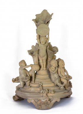 A Terracotta Figural Group Epergne Of Children Seated