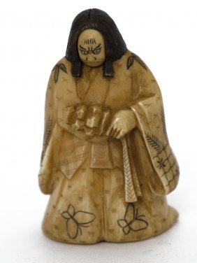 A Japanese Ivory Carving Of A Kabuki Theatre Actor With