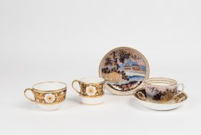 A Spode Trio Decorated With Flowerheads Within Blue And