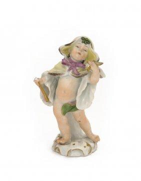 A Meissen Figure Of Cupid In A Cape, Blue Crossed Sword