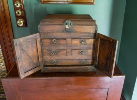 A Small Chinese Iron Bound Cabinet With Hinged Top