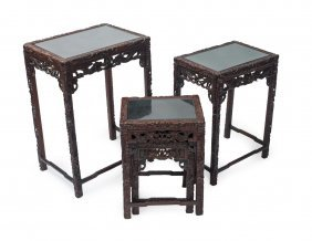 A Chinese Carved Cherrywood Nest Of Four Glass Topped