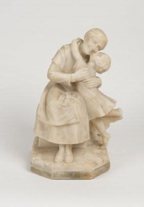 A Victorian Alabaster Figure Of A Seated Mother Holding
