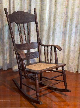 A Victorian Oak Rocking Chair