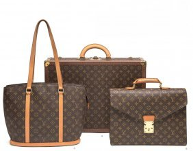 A Bisten Monogram Suitcase, Louis Vuitton. Features