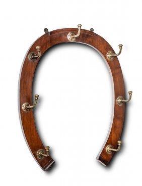 A Mahogany And Brass Horse-shoe Shaped Coat Rack,