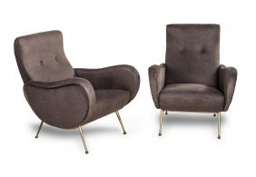 A Pair Of Chocolate Brown Upholstered And Brass Legged