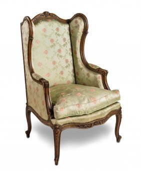 A Carved Walnut Wing Armchair French, 19th Century