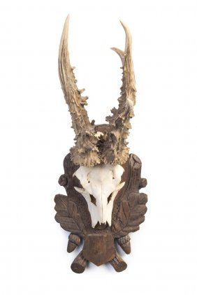 A Pair Of Mounted Deer Antlers On Carved Wall Mounts