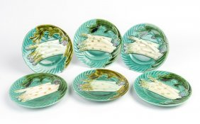 A Set Of Six Green Glazed Faience Dishes With Asparagus