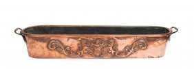 A Copper Repousse Twin Handled Elongated Jardiniere,