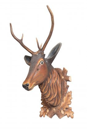 A Carved Wood And Polychrome Decorated Stag's Head,