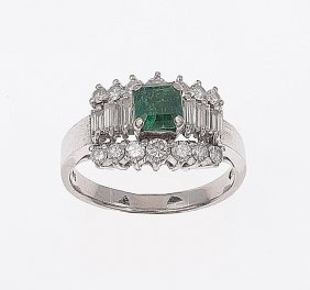 An Emerald And Diamond Ring. The Square Emerald