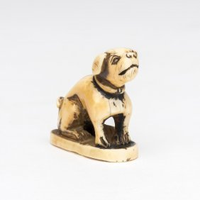 An Ivory Netsuke Of A Seated Puppy, Meiji Period