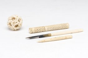 A Chinese Ivory Mystery Ball, Needle Case And Pen