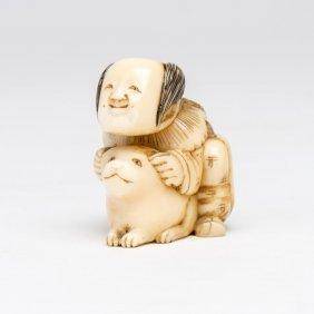An Ivory Netsuke Of A Crouching Man And A Puppy, Meiji