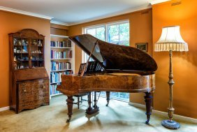 A Blüthner Walnut Grand Piano, No. 86983, And A