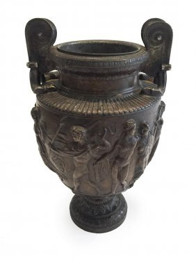 A Bronzed Metal Urn With Relief Classical Figures
