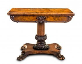 A Victorian Walnut Card Table With Carved Frieze Above