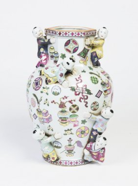 A Chinese Porcelain Vase Applied With Figures Of