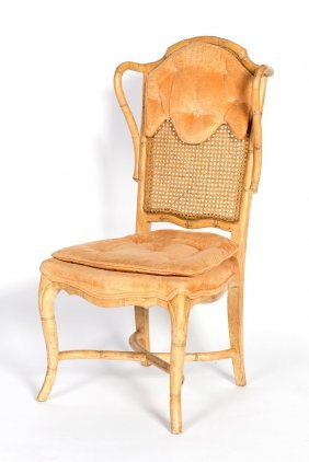 A Carved Simulated Bamboo Cane Back Occasional Chair