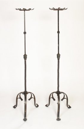 A Pair Of Wrought Iron Pricket Candle Sticks On Tripod