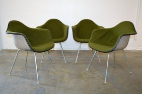 Four Eames Arm Chairs In Green