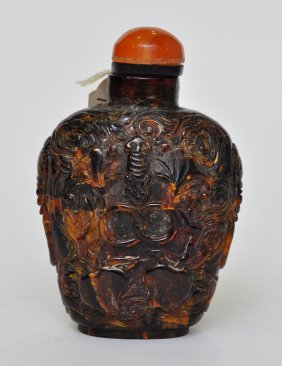 A Chinese Amber Carved Snuff Bottle