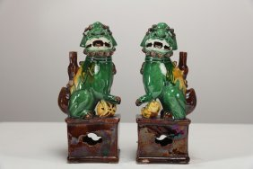 Arte Cinese A Pair Of Green, Brown And Yellow Glazed