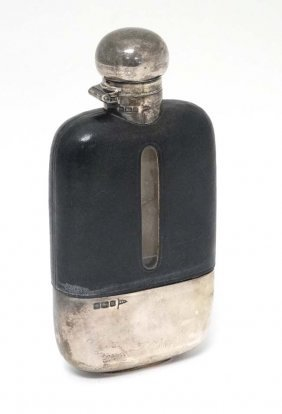 A Silver And Half Leather Covered Glass Hip Flask With
