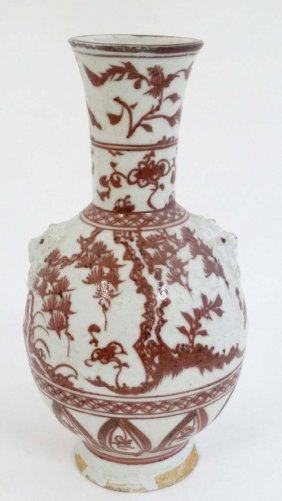 A Chinese Iron Red And White Pottery Bottle Vase With
