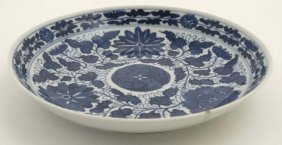 A Chinese Blue And White Dish Decorated With Peonies