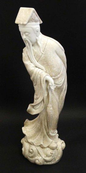 A Chinese Blanc De Chine Crackle Glaze Figure Of A Sage