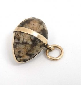 A Pendant Formed As An Agate Hardstone Egg Within A