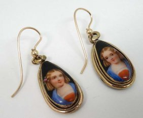 A Pair Of Drop Metal Gilt Earrings Set With Hand