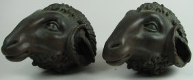 Pair Of Cast Bronze Ram Heads