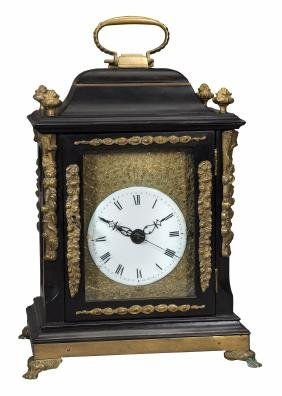 A Chinese Brass Mounted Ebony Small Table Clock In The