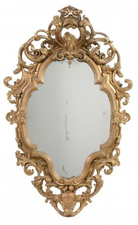 A Carved Giltwood And Composition Wall Mirror , Second