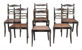 A Set Of Six Regency Ebonised And Parcel Gilt Dining