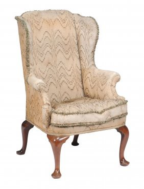 A George Ii Mahogany And Upholstered Wing Armchair,