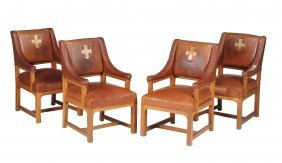 A Set Of Four Oak And Leather Upholsted Armchairs ,