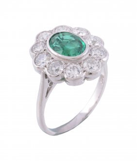 An Emerald And Diamond Ring, The Central Oval Cut