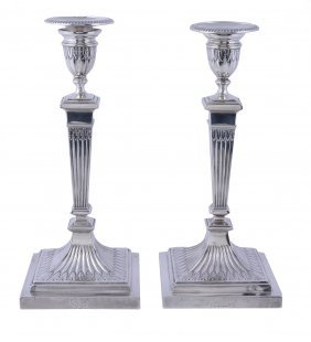 A Pair Of Victorian Silver Square Candlesticks By