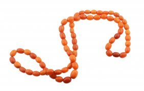 An Amber Bead Necklace, Composed Of Oval Shaped Amber