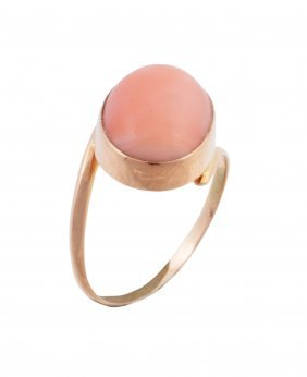 A Coral Ring, The Oval Cabochon Coral In A Collet