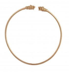 A Gold Torc Necklace, The Hollow Band Set With A Lion's